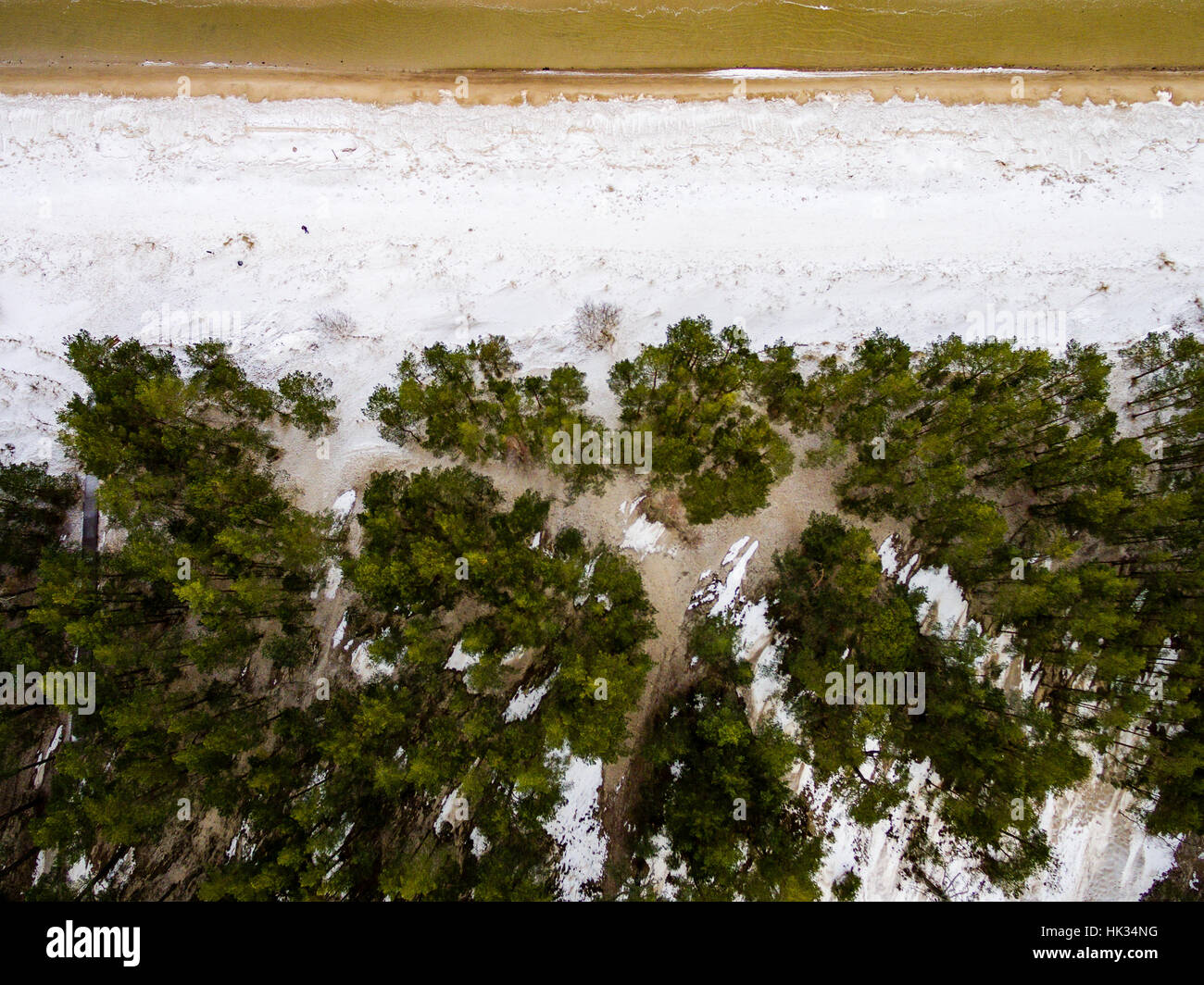 aerial view of frozen beach in winter. drone photography. sea with waves. - Stock Image