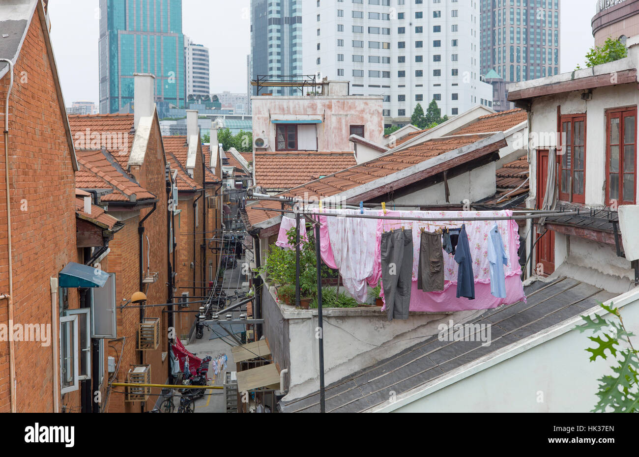 Washing drying in backyard of housing, Shanghai, China - Stock Image