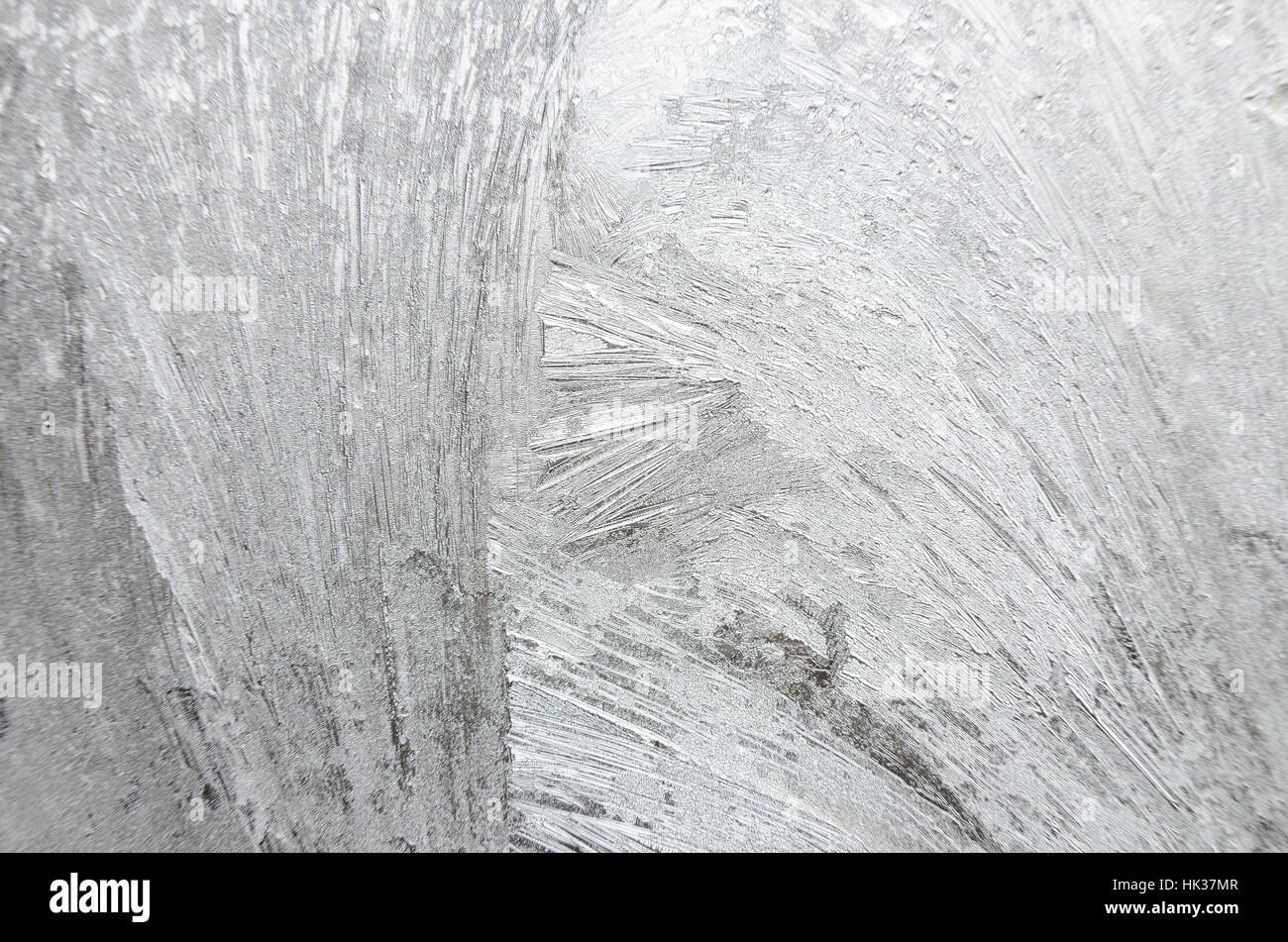 Surface of windowpane with frostwork as a background - Stock Image