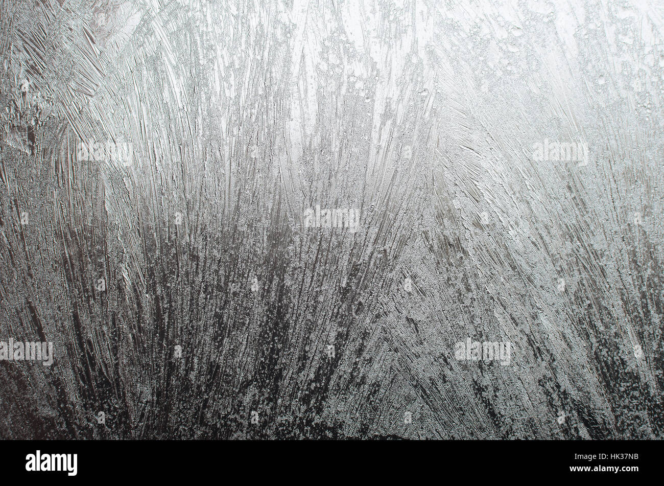 Surface of a window glass with frostwork as a background Stock Photo