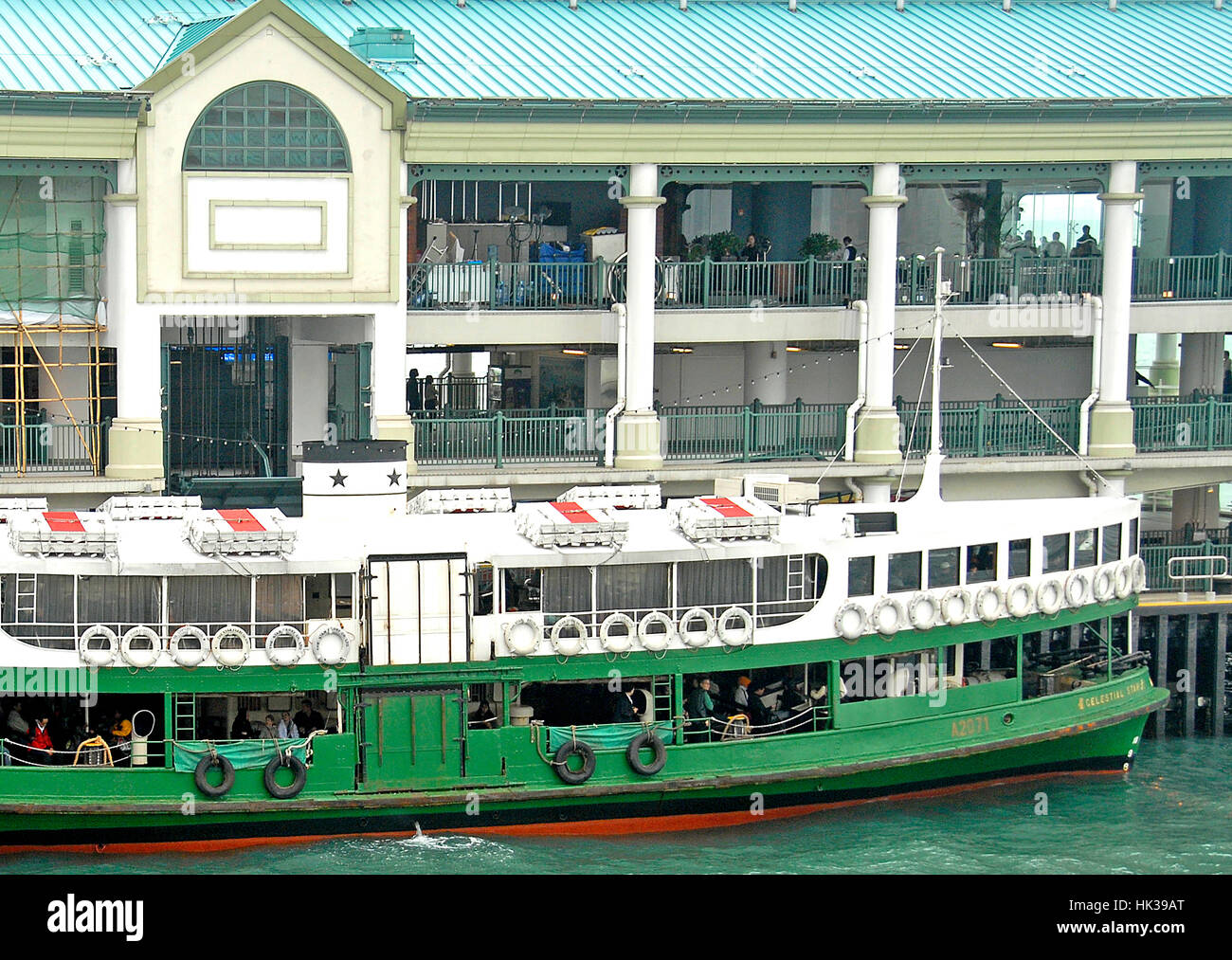 Celestial Star ferry, currently the oldest vessel in service, at pier Victoria bay, Hong Kong, China - Stock Image