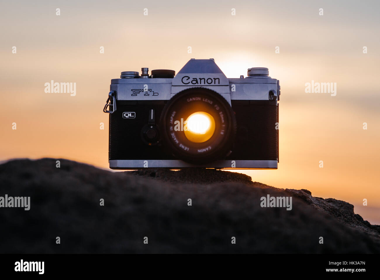 Sunset through Canon FTB lens, camera on a rock - Stock Image