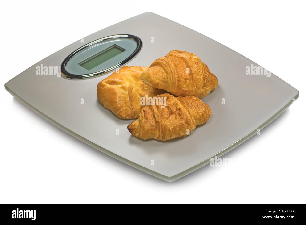 Digital Bathroom Scale And Croissants, Isolated Studio Shot Closeup - Stock Image
