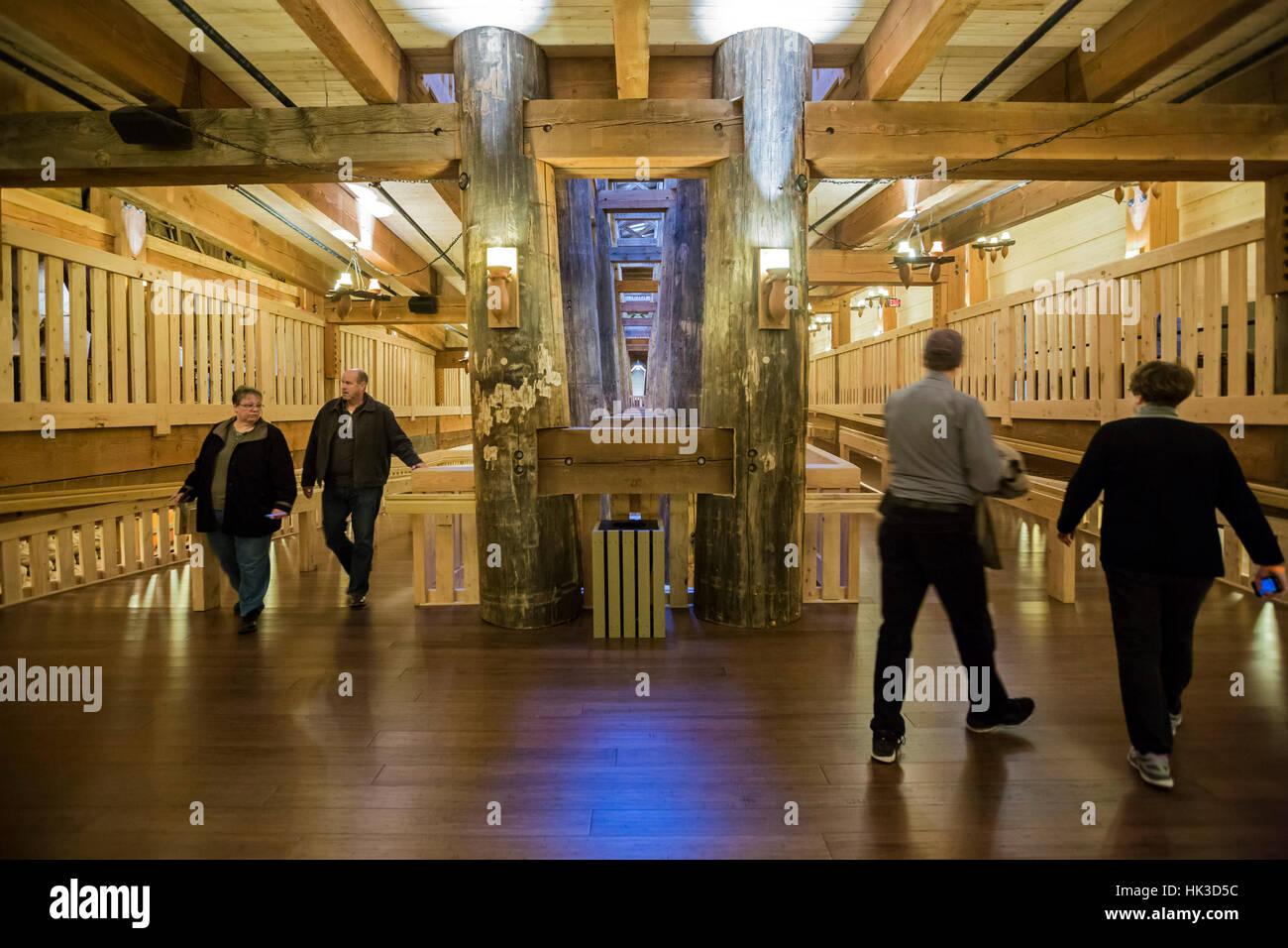 Williamstown, Kentucky - Visitors walk between decks at the Ark Encounter, a full-sized model of Noah's Ark. - Stock Image