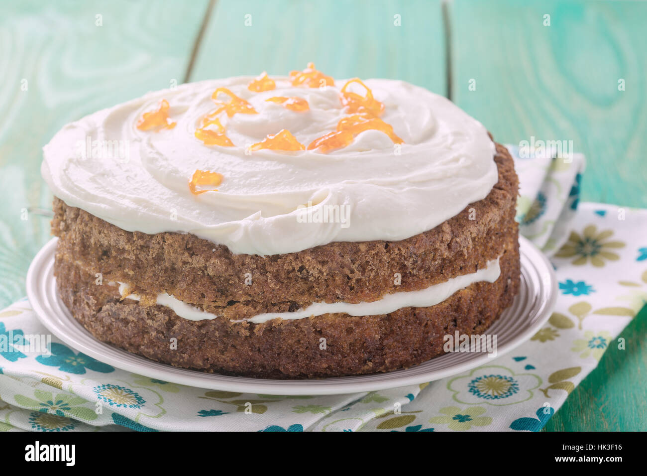 Mother's day carrot cake, homemade moist and sweet layer cake with grated carrot,  walnuts and dried apricot - Stock Image