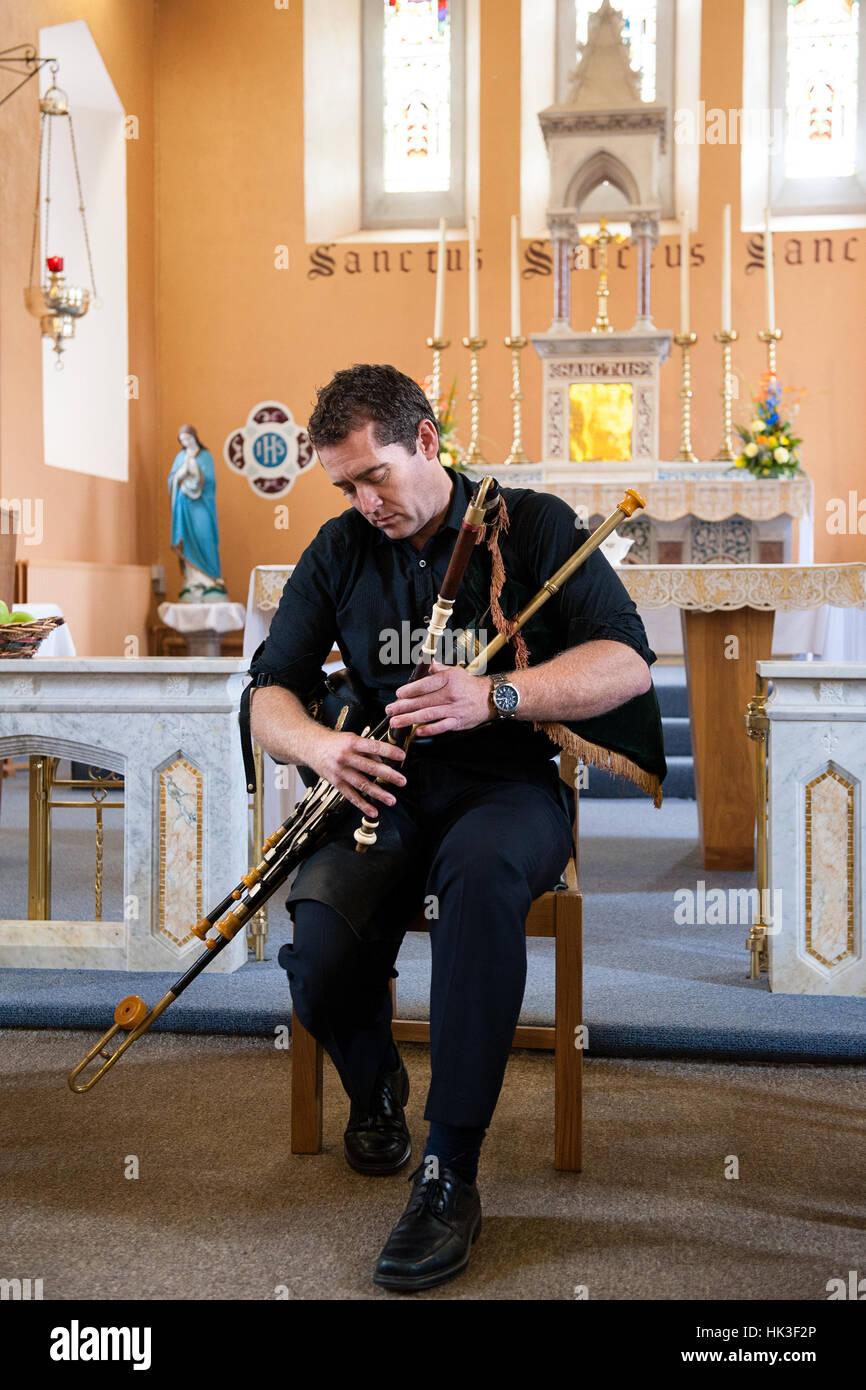 Uilleann Piper David Power playing the uilleann pipes, a traditional Irish instrument - Stock Image