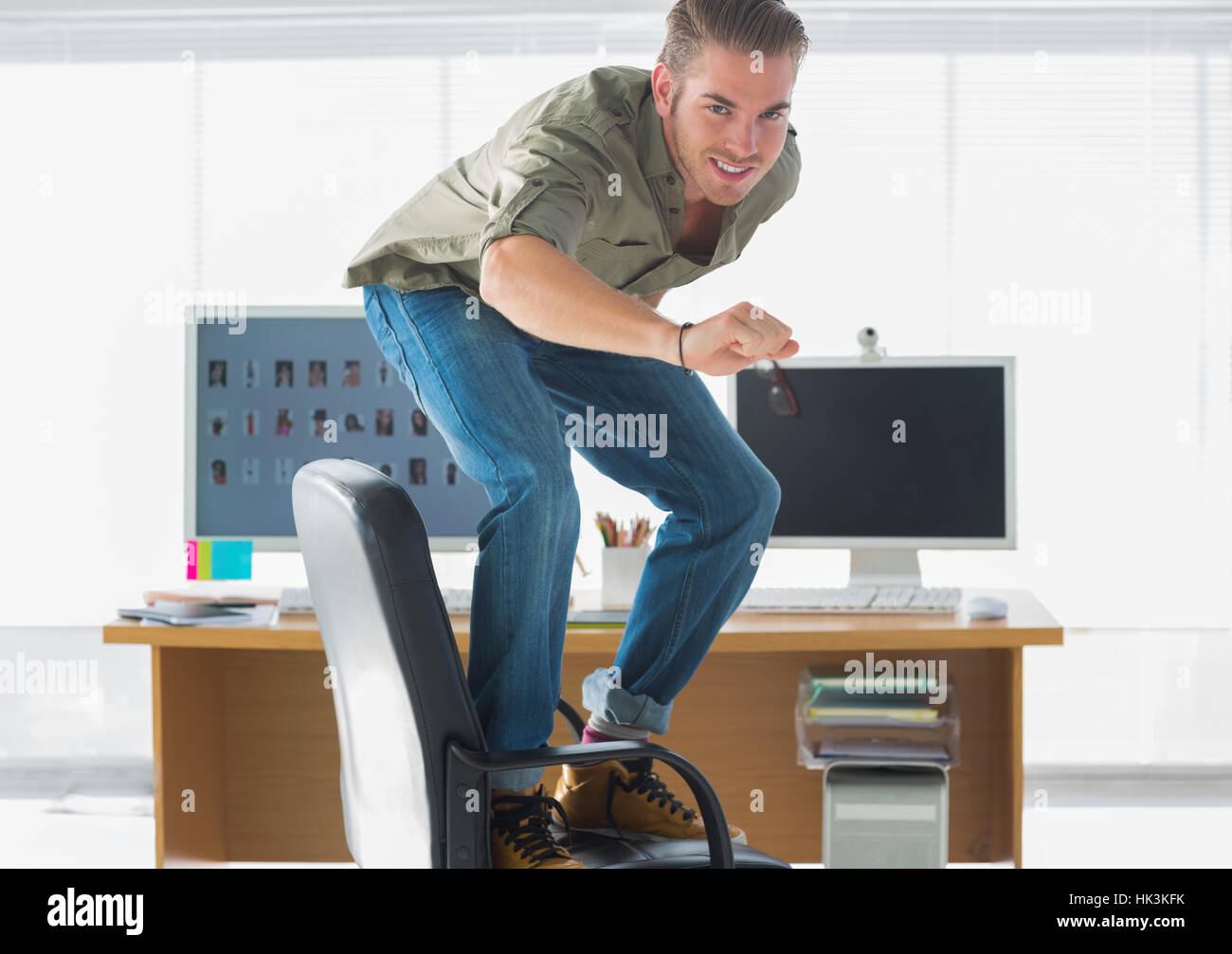 Miraculous Smiling Man Surfing His Office Chair And Having Fun Stock Pabps2019 Chair Design Images Pabps2019Com