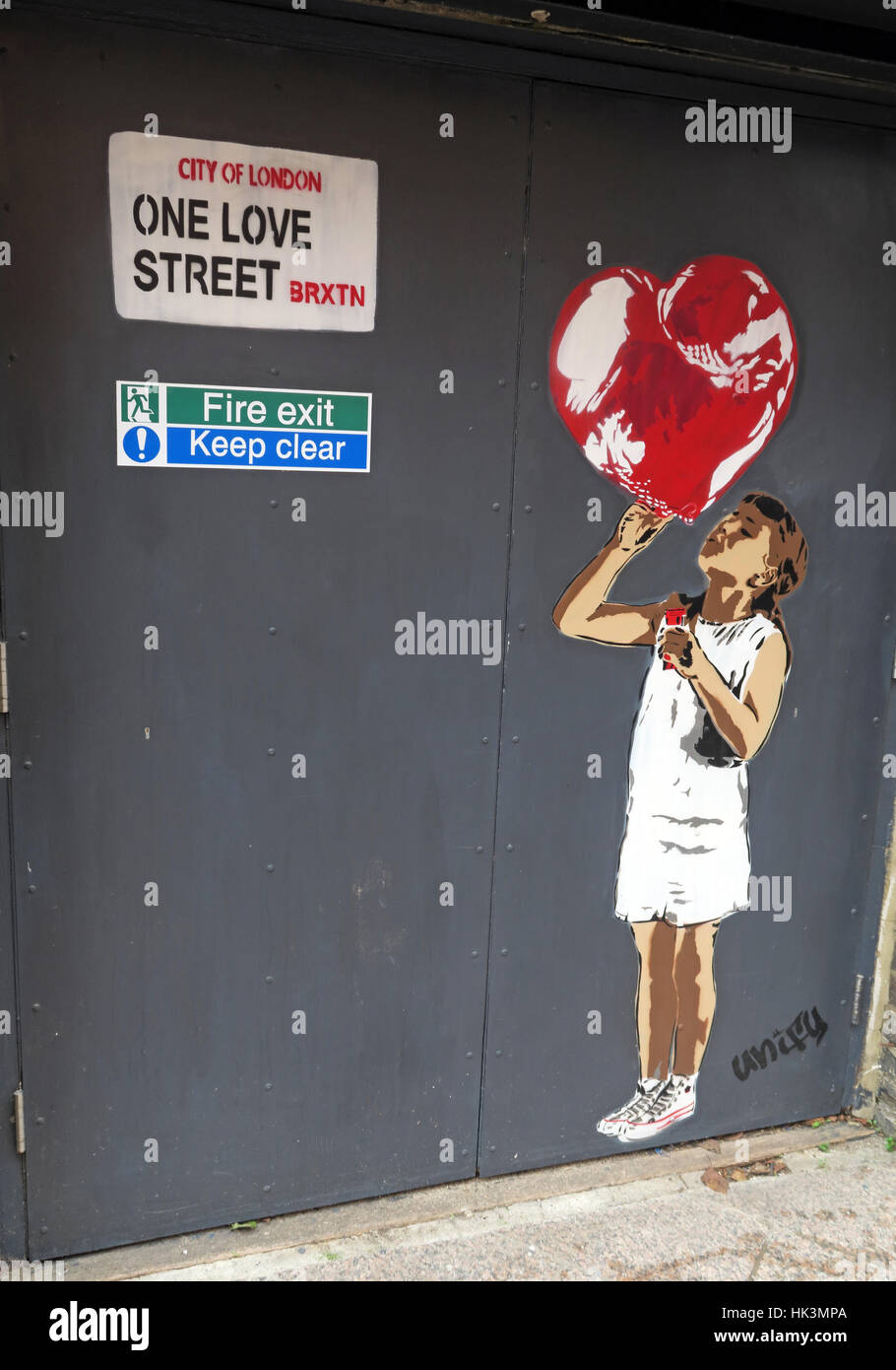 Street art in Brixton London, England, UK - One Love street girl with balloon - Stock Image