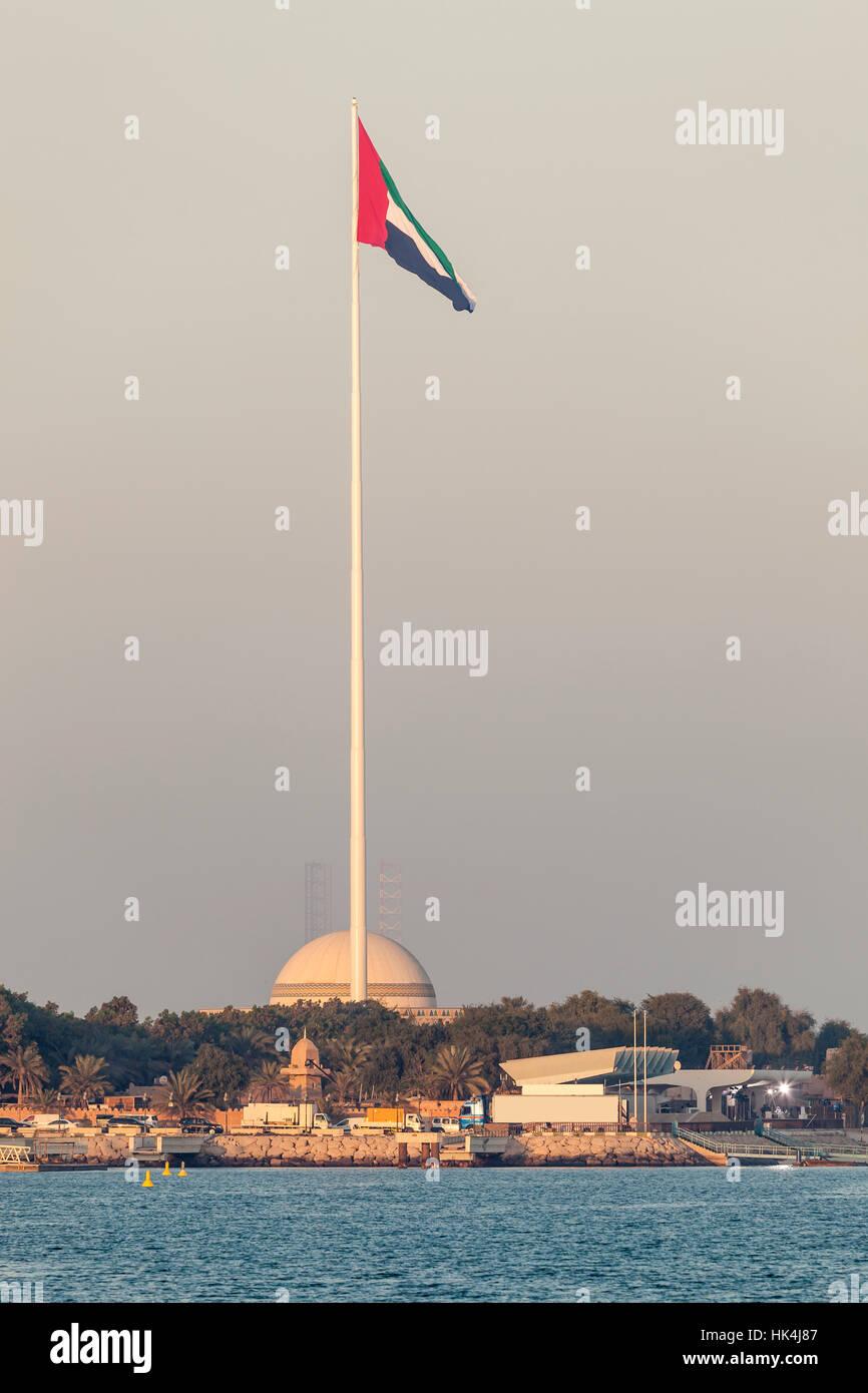 Flagpole with the UAE natinal flag in Abu Dhabi - Stock Image