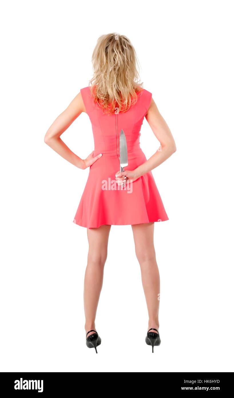 pretty slender woman hidden kitchen knife behind back Stock Photo ...
