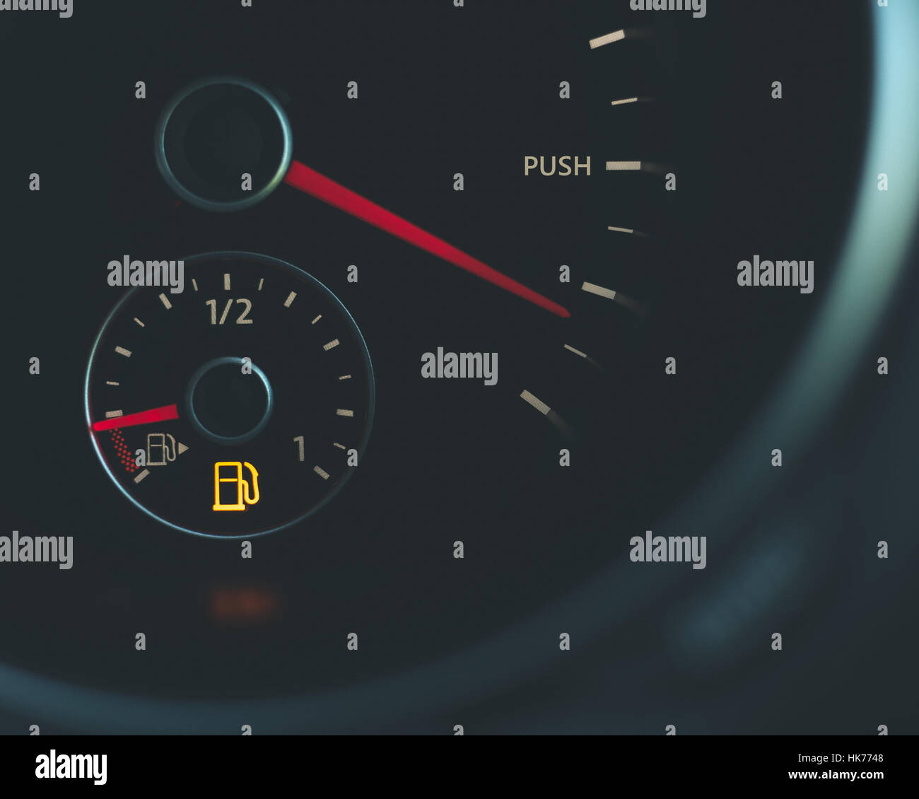 Push limits running on empty Car speedometer with word push fuel gauge with red needles and fuel light black silver - Stock Image