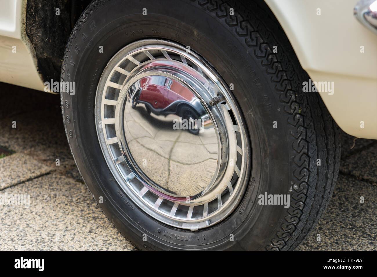 Hub Cap Stock Photos Images Alamy Alfa Romeo Wheel Centre Caps Austin Seven Reflected In The Chrome Of A Vauxhall Viva Image