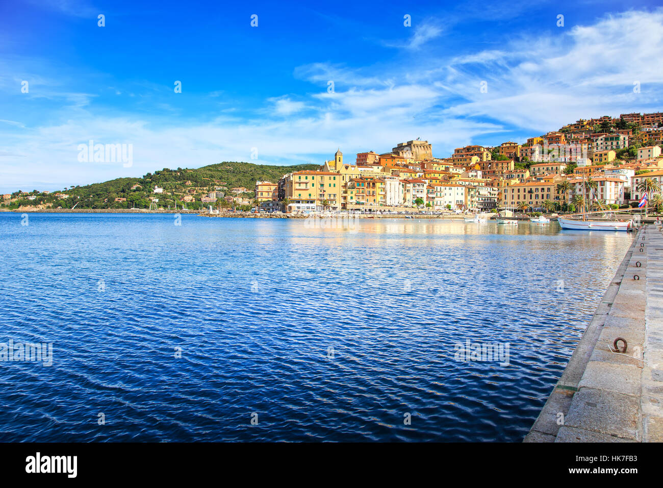 Porto Santo Stefano harbor seafront and village skyline, italian travel destination. Monte Argentario, Tuscany, Stock Photo