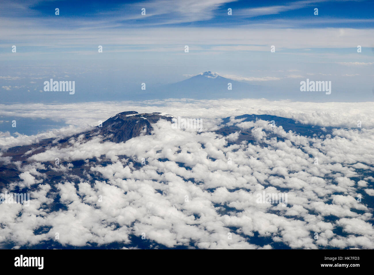 Tanzania, aerial view Mount Kilimanjaro 5895 metre in the back and volcano Mount Meru 4562 metre in the front / - Stock Image