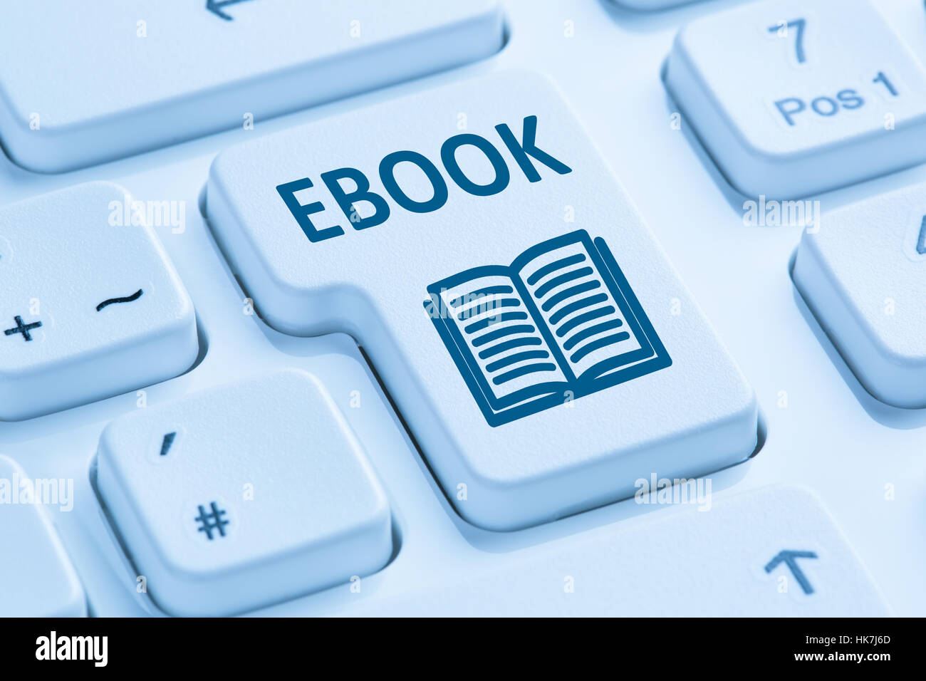 Ordering E-book Ebook download internet symbol blue computer keyboard - Stock Image