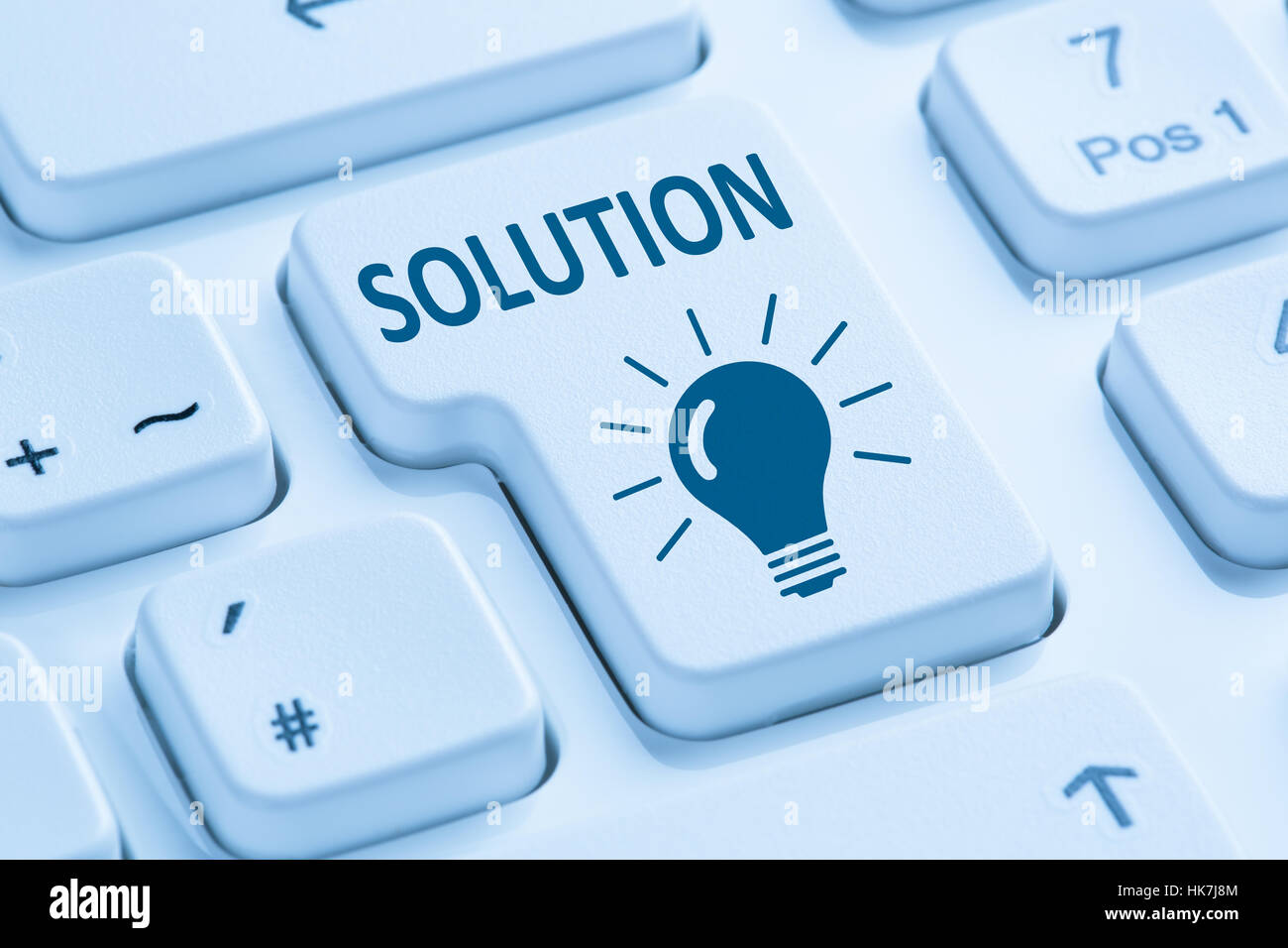 Finding solution for problem conflict button symbol internet blue computer keyboard - Stock Image