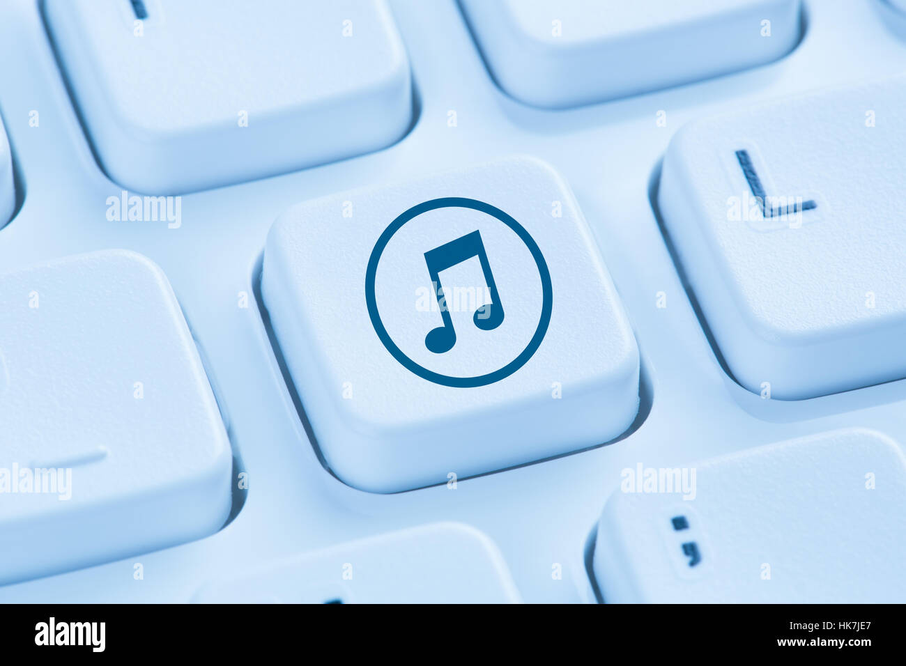 Listening download downloading streaming music internet blue symbol computer keyboard - Stock Image