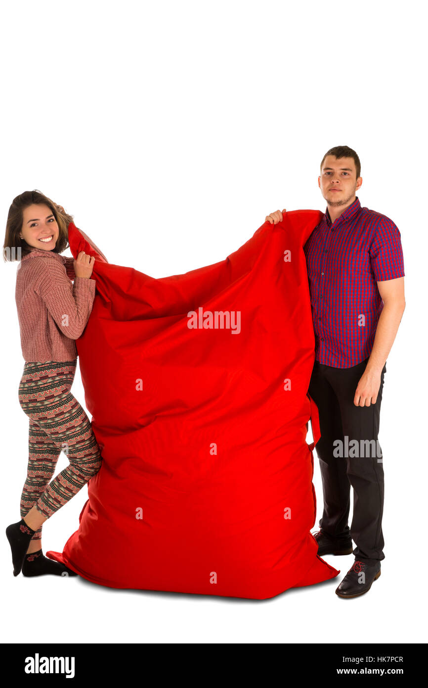 Cool Young Woman And Man Standing And Holding Red Rectangular Ocoug Best Dining Table And Chair Ideas Images Ocougorg