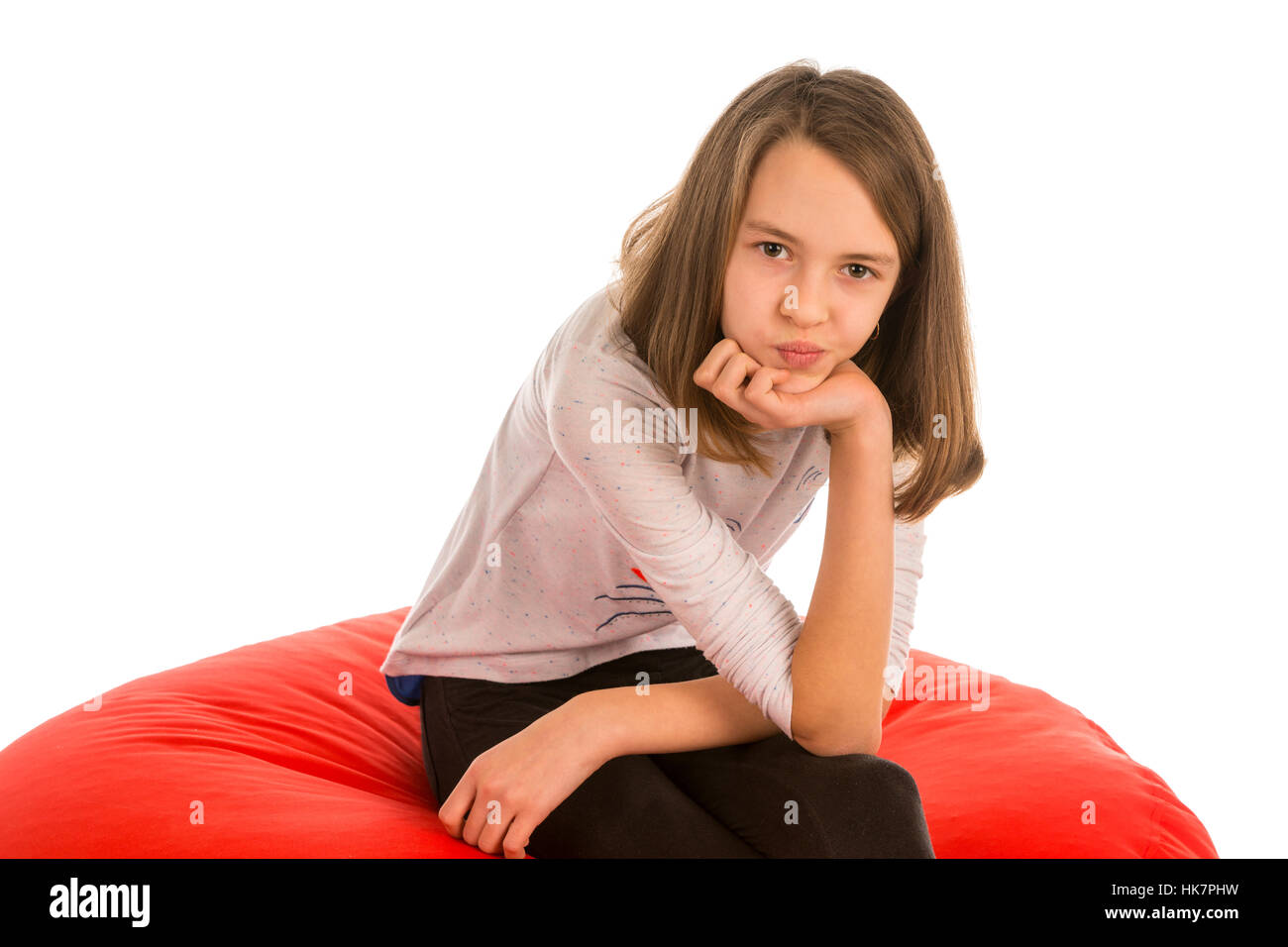 Amazing Cute Girl Sitting On Round Shape Red Beanbag Chair Isolated Pdpeps Interior Chair Design Pdpepsorg