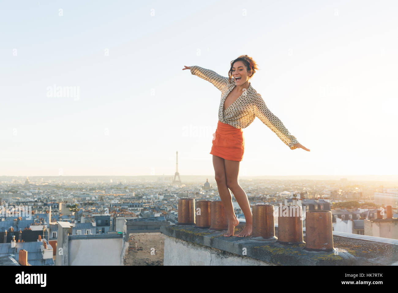 Paris, Happy woman enjoying view on the roofs of Paris - Stock Image
