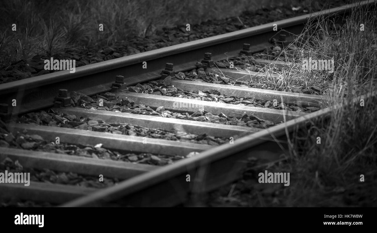 Weathered rail line in black and white - Stock Image