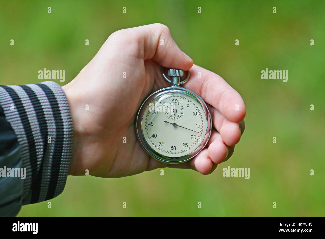Stop watch in a hand - Stock Image