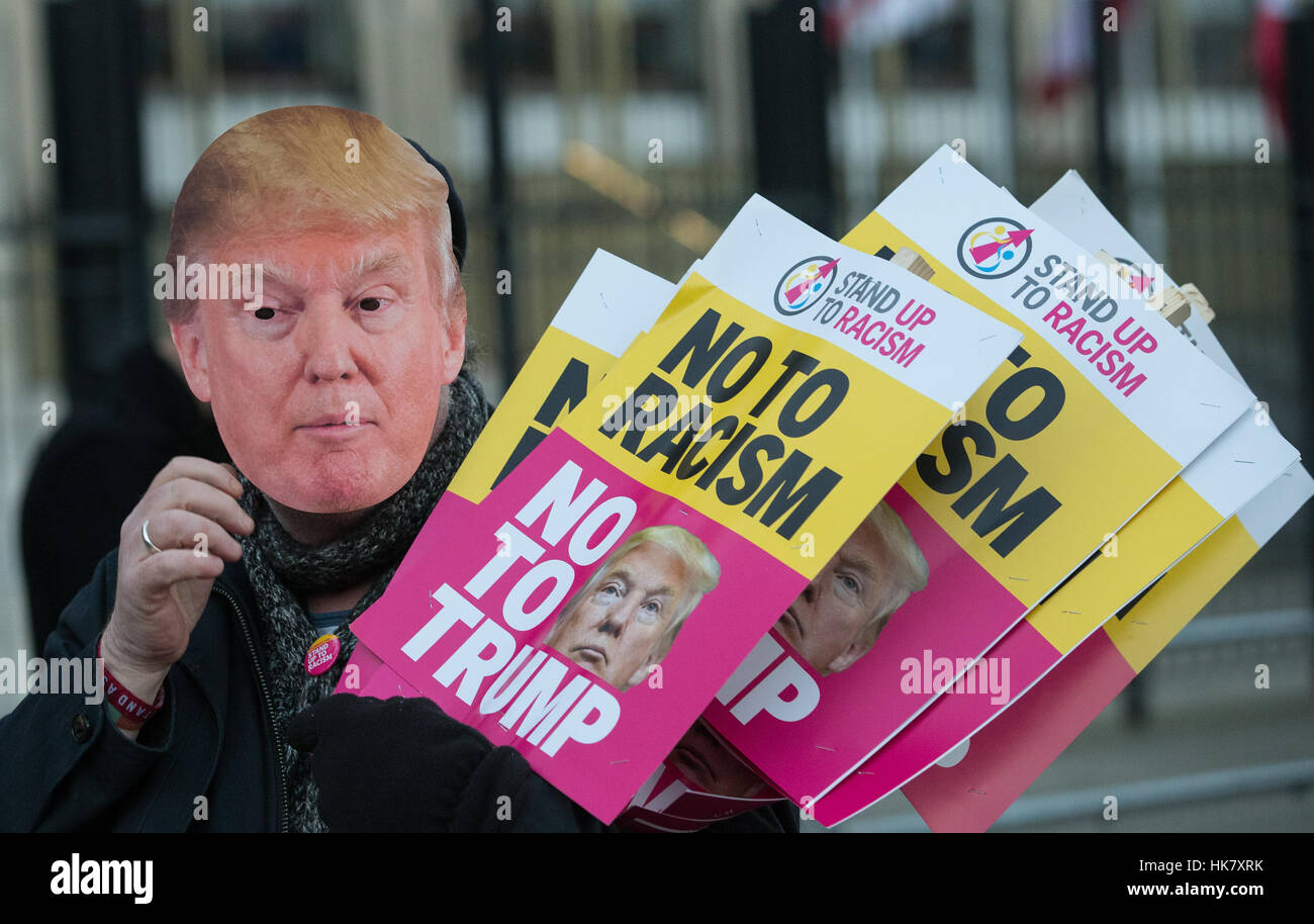 Protest outside the American Embassy in Grosvenor square,London against President Trump and especially his Nuclear - Stock Image