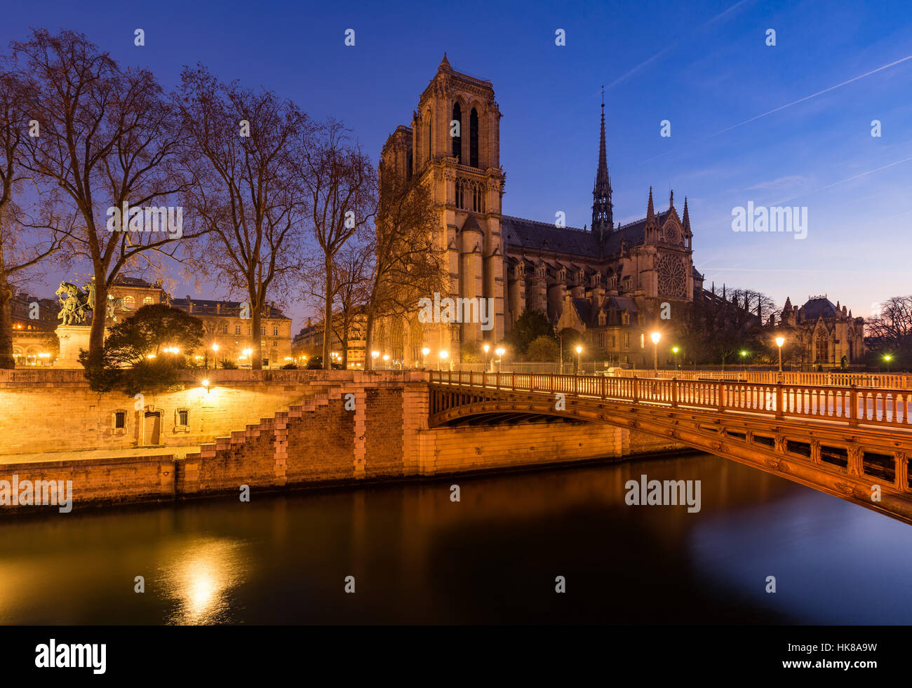 Notre Dame de Paris cathedral at dawn with the Seine River and the Pont au Double. Ile de La Cite. 4th Arrondissement, - Stock Image