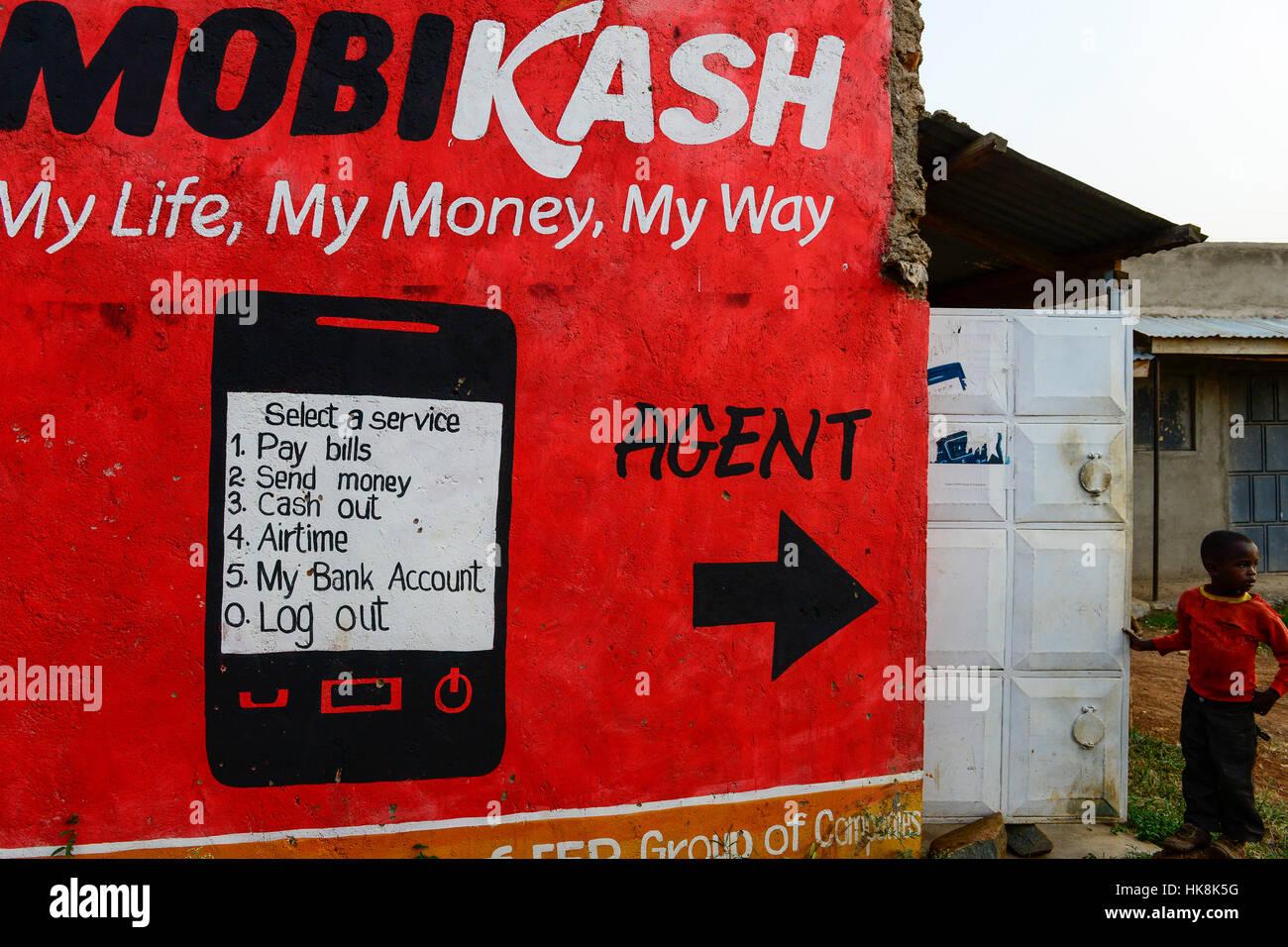 KENYA, County Siaya, village Kotanega, pay by mobile phone, ad Mobicash / KENIA, County Siaya, Dorf Kotanega, bezahlen per Mobiltelefon, MOBICASH Stock Photo