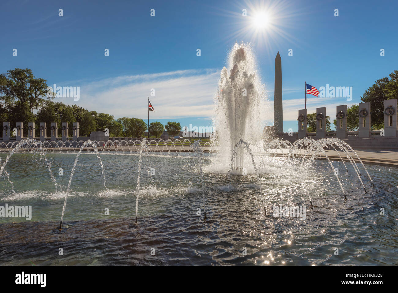 The fountains of the War memorial and the Washington Monument on a summer morning in Washington DC. - Stock Image
