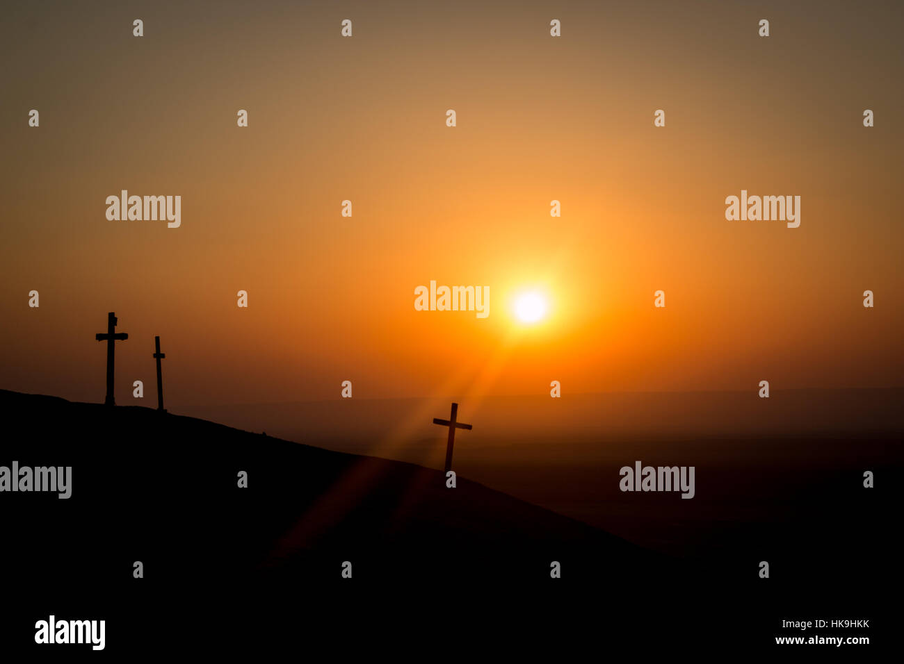 Three crosses at the top of a mountain at St. Anthony's Monastery in Egypt at sunset Stock Photo