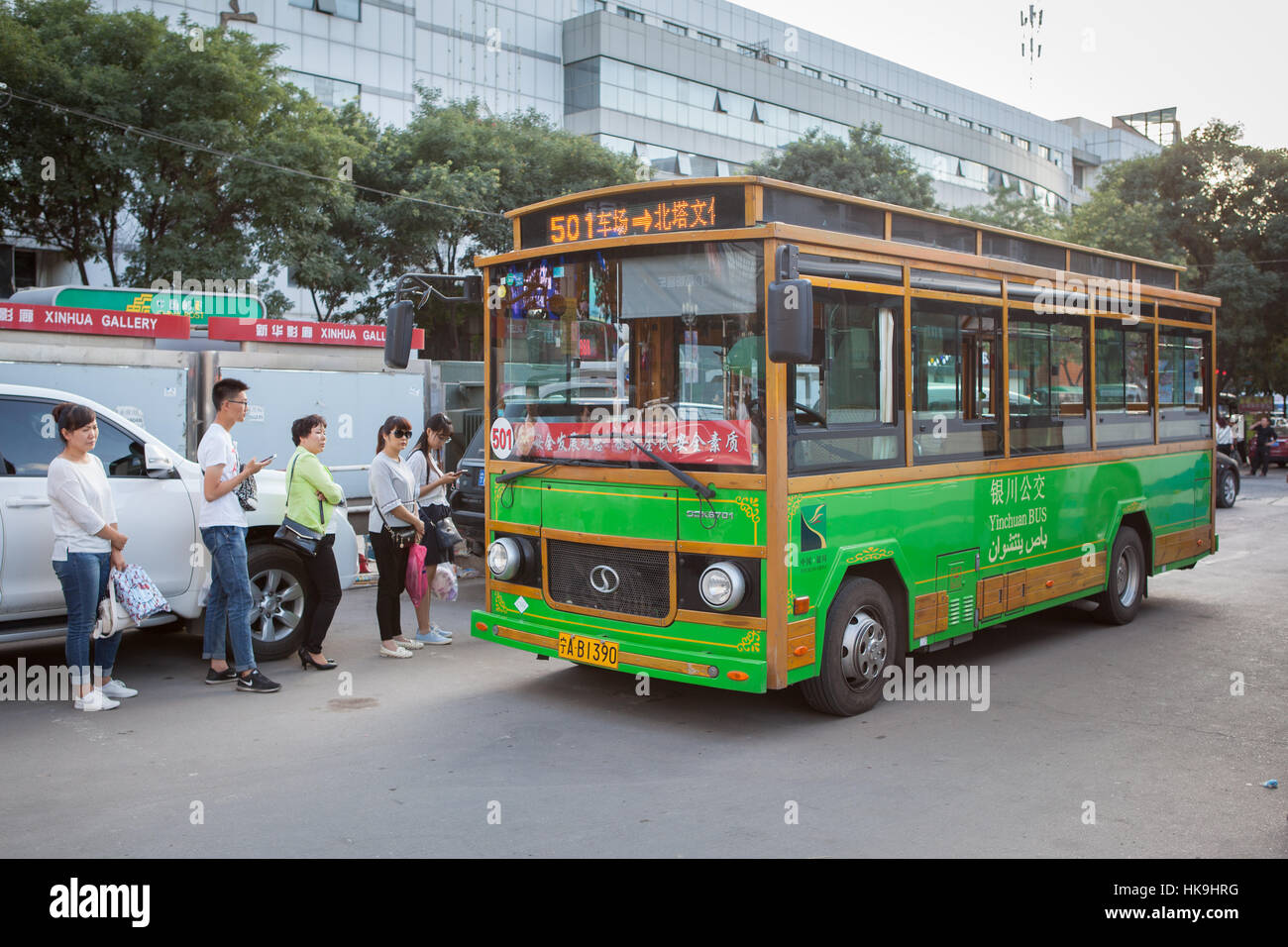People getting onto the typical urban bus. Yinchuan, Ningxia, China Stock Photo