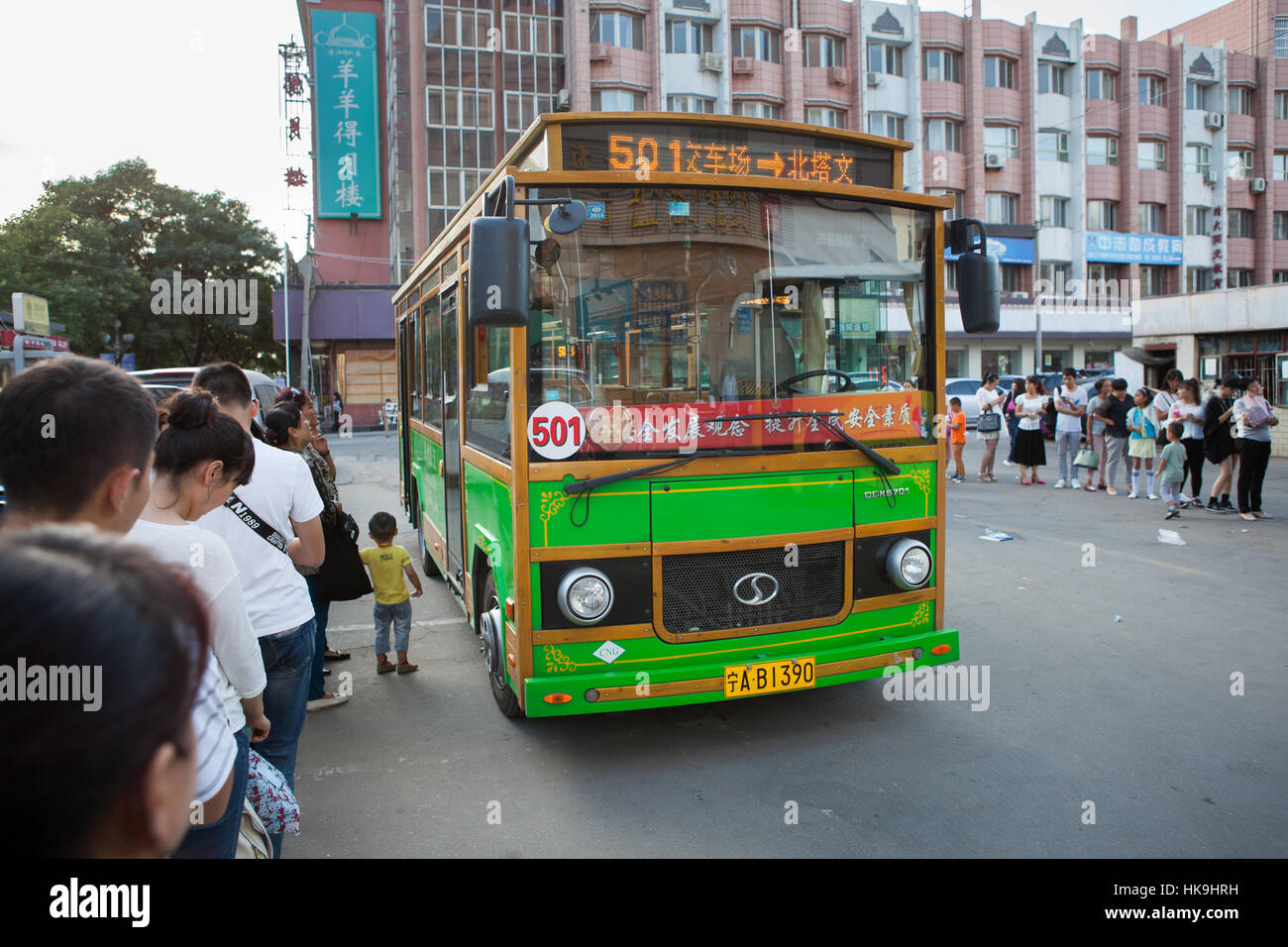 People wiating to get onto the typical urban bus. Yinchuan, Ningxia, China Stock Photo