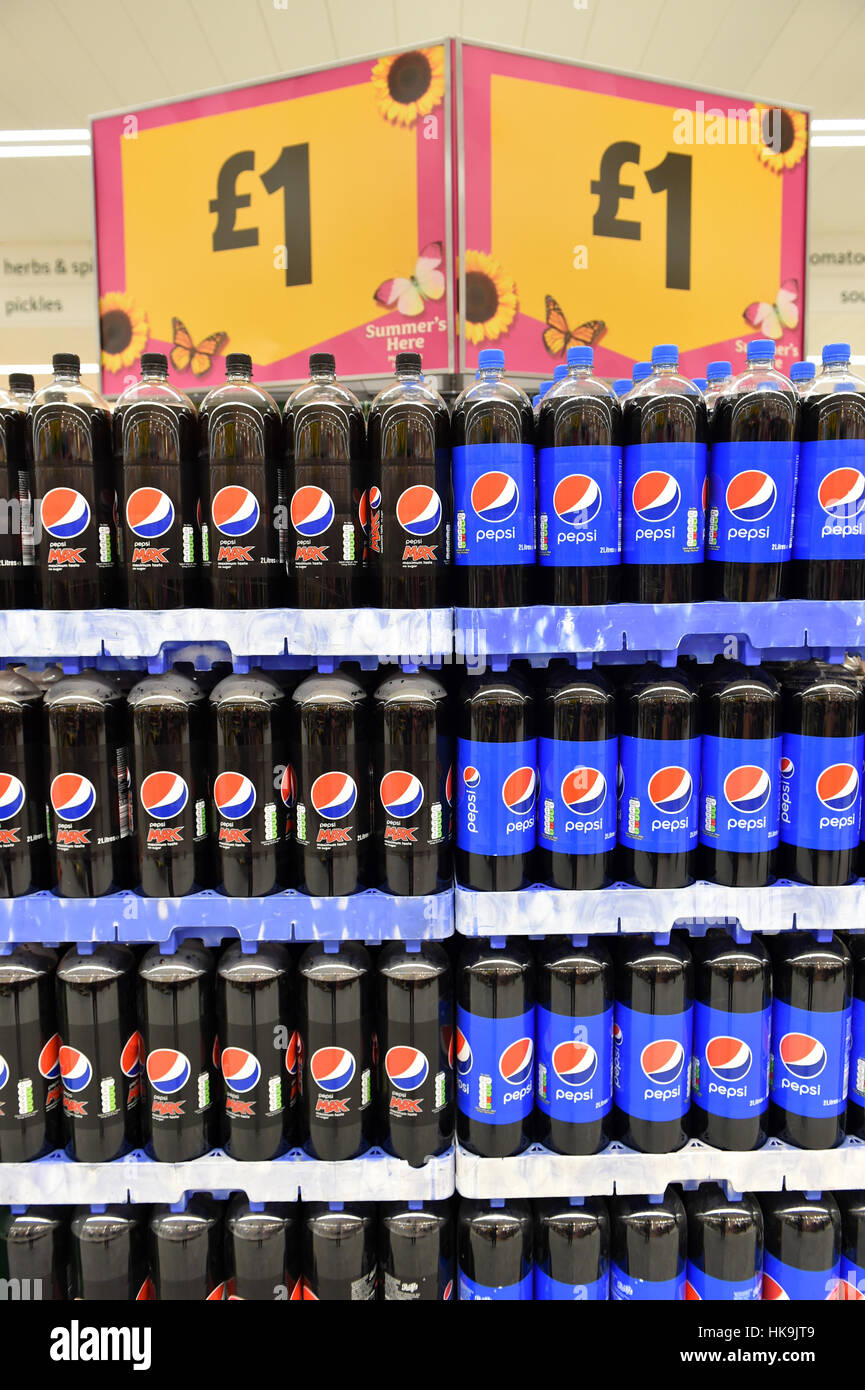 Fizzy drinks on sale for £1 in a supermarket, Yorkshire. - Stock Image