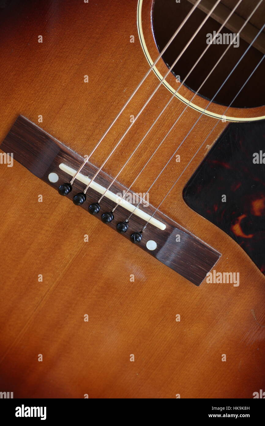 Close up of acoustic guitar strings and bridge - Stock Image