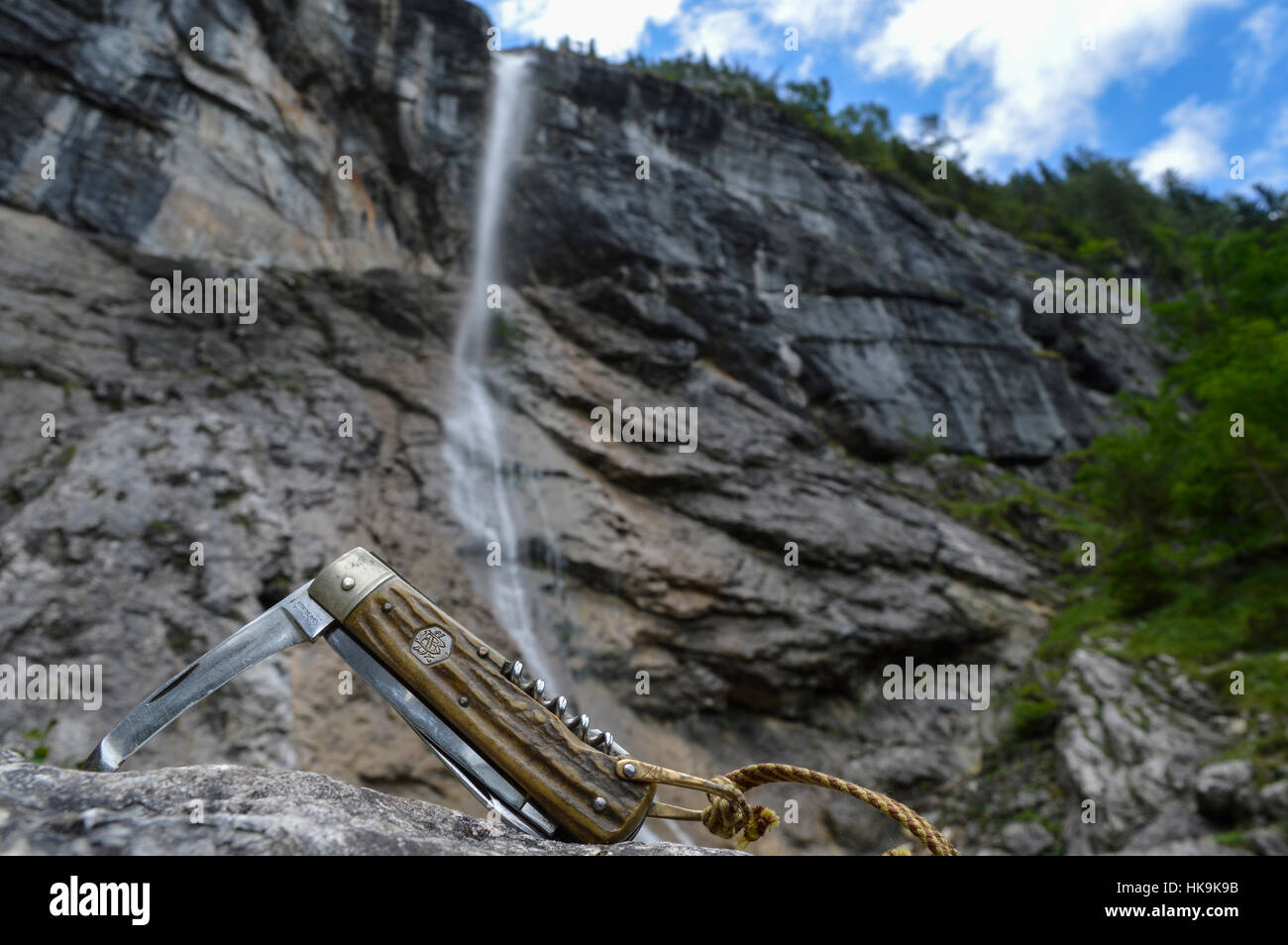 Pocket knife and Waterfall - Stock Image