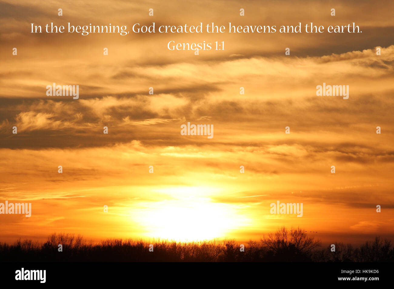 In The Beginning. Bible Verse Over A Sunset Stock Photo