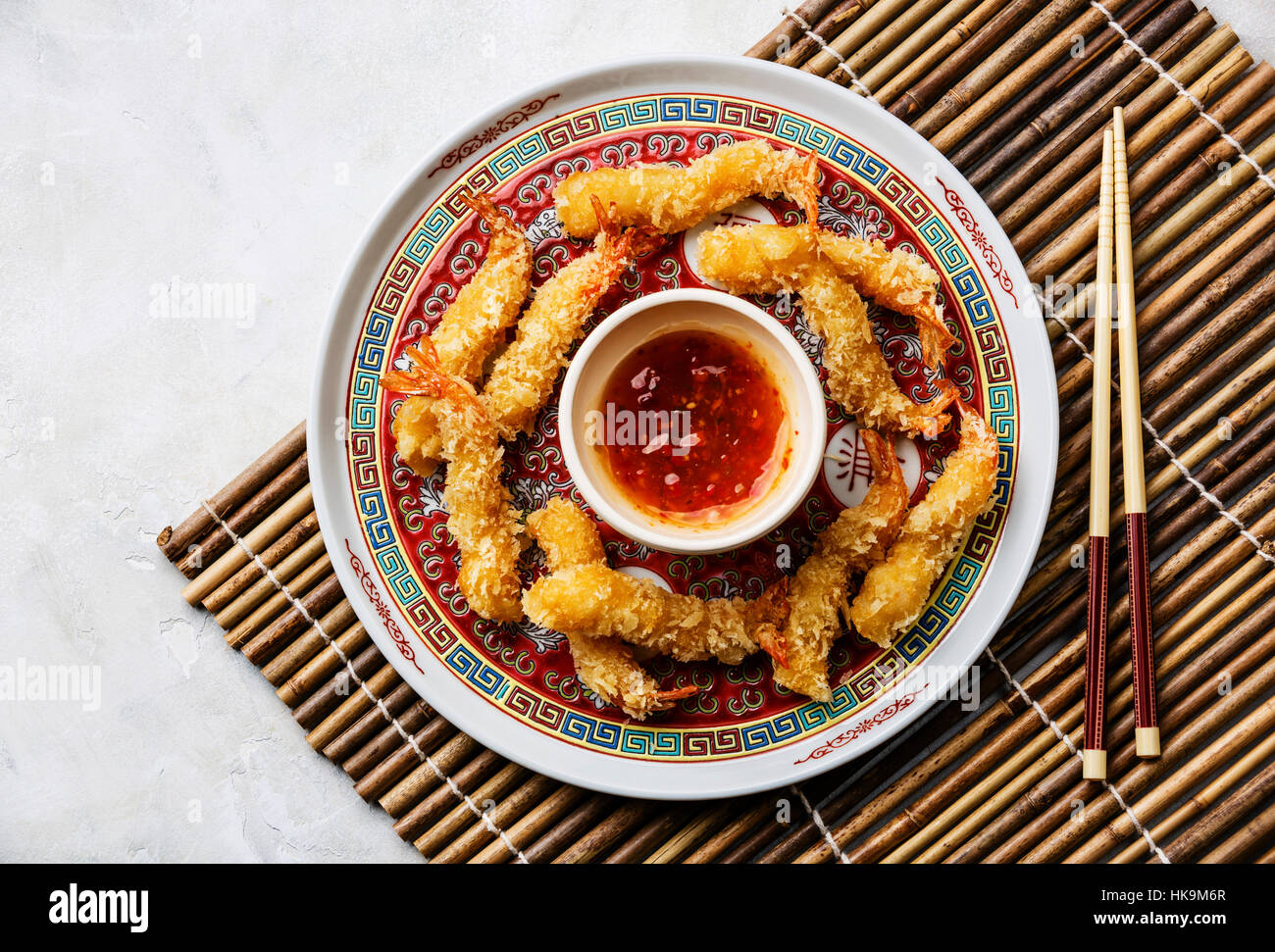 Deep fried breaded Tempura prawn shrimps with sauce on bamboo background - Stock Image