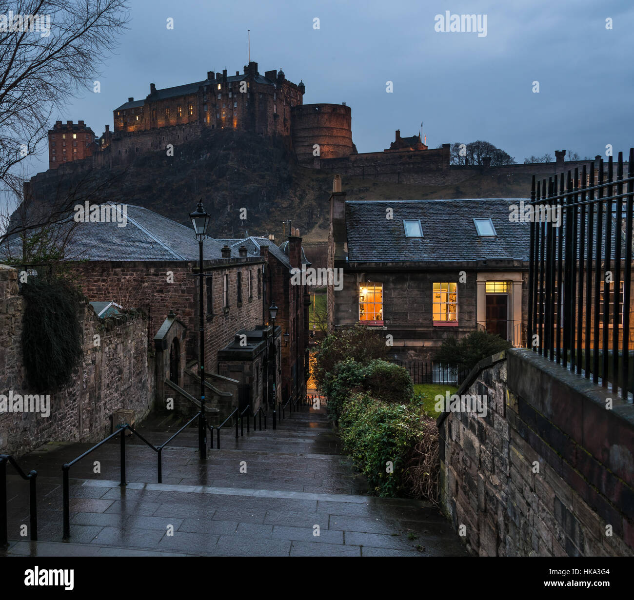 The Vennel and Edinburgh Castle an old stepped passageway leading to the Grassmarket area of the city - Stock Image