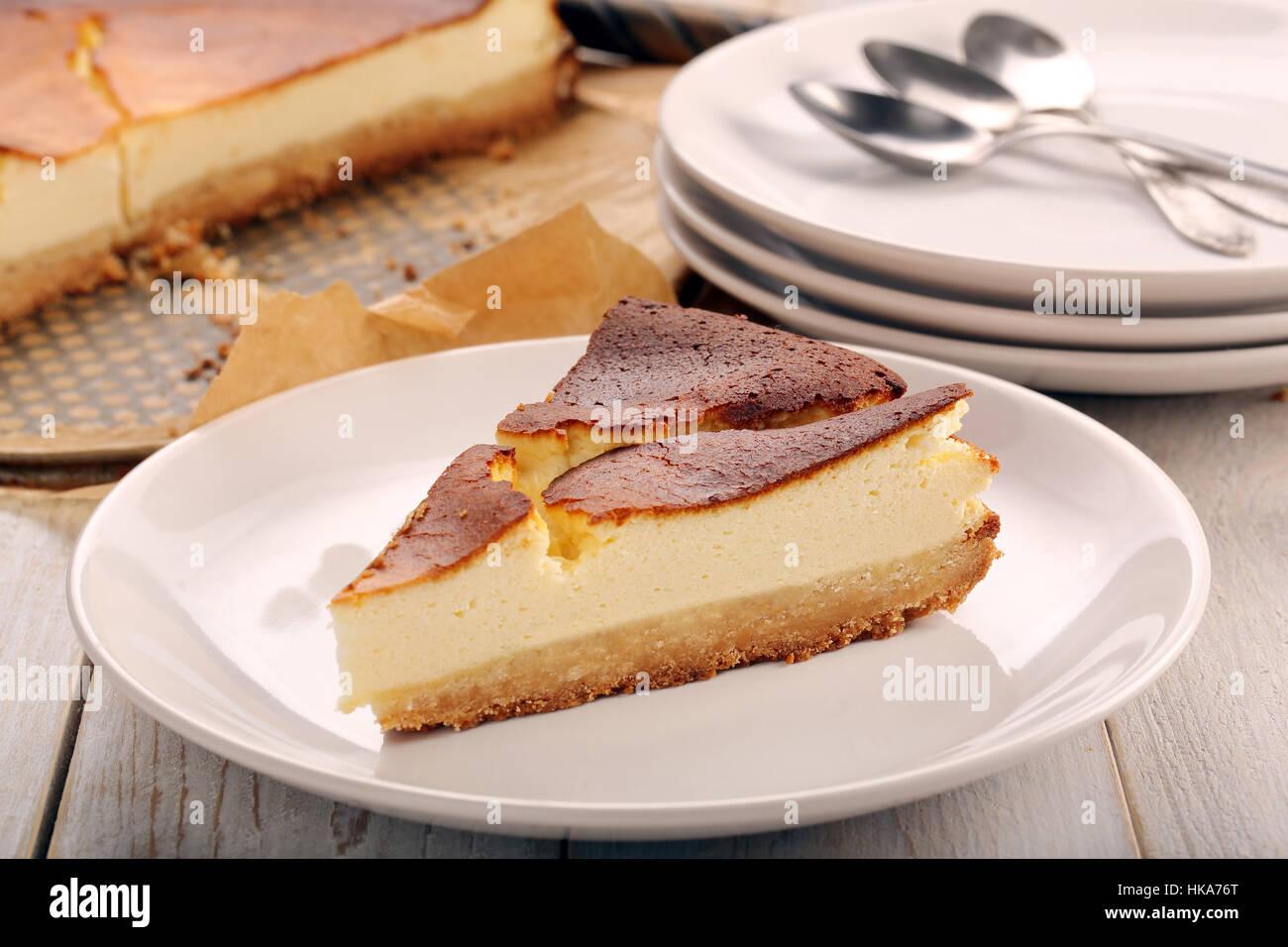 Cheesecake slice on wooden background - Stock Image