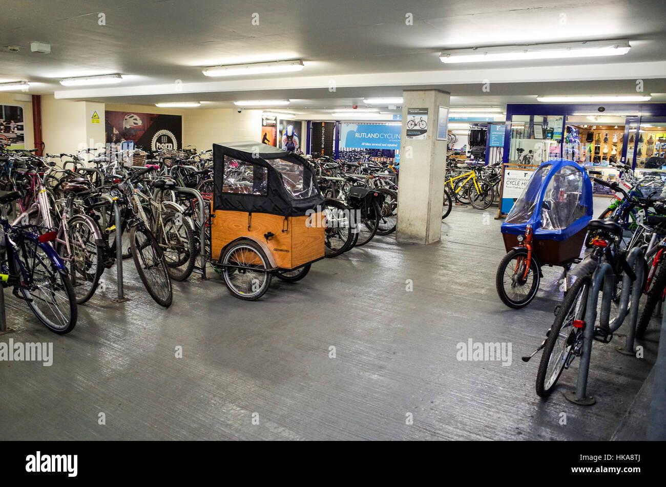 Assorted bikes parked in the bike park under the Grand Arcade development, Cambridge UK - Stock Image