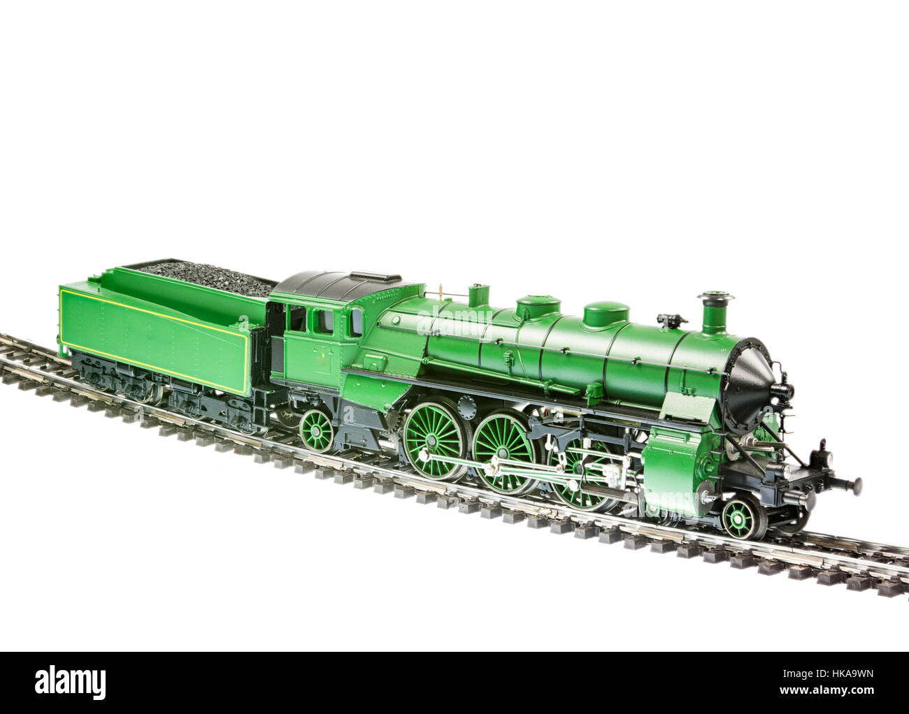 Isolated toy train with a steam engine locomotive - Stock Image