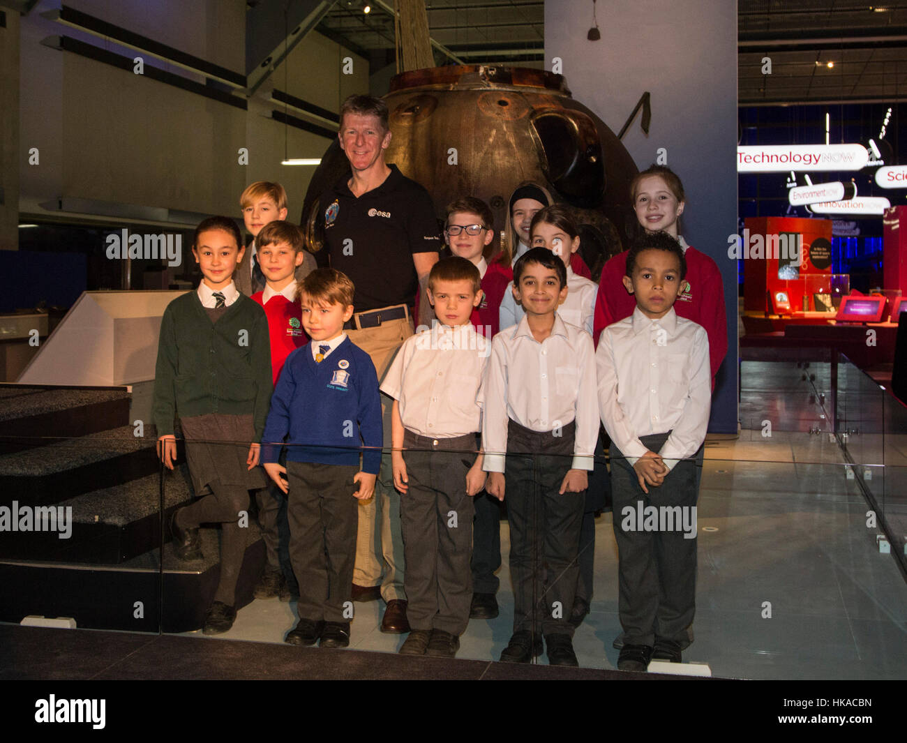 London, UK. 26 January 2017. Tim Peake with pupils from Barnes Primary School. The Science Museum unveils the Soyuz - Stock Image