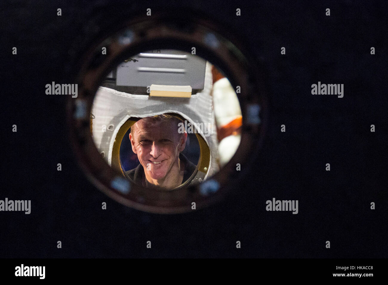 London, UK. 26 January 2017. Tim Peake peeks through a window of the Soyuz TMA-19M. The Science Museum unveils the - Stock Image