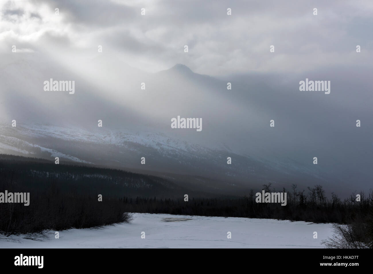 Winter storm clouds, Kluane Mountains and Dezadeash River, near Haines Junction, Yukon Territory - Stock Image