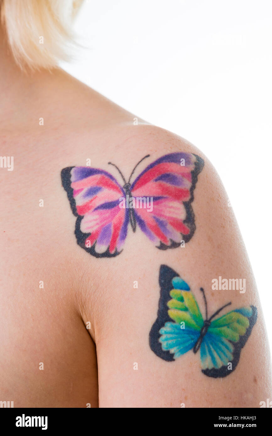 Woman With Butterfly Tattoos On Her Bare Shoulder Stock Photo