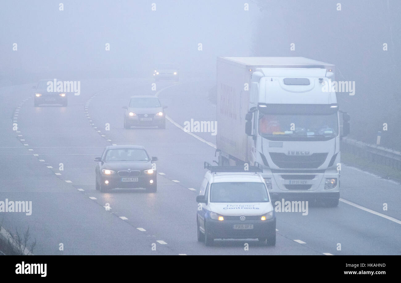 Foggy driving conditions on the M20 motorway, Ashford, Kent, England, UK - Stock Image
