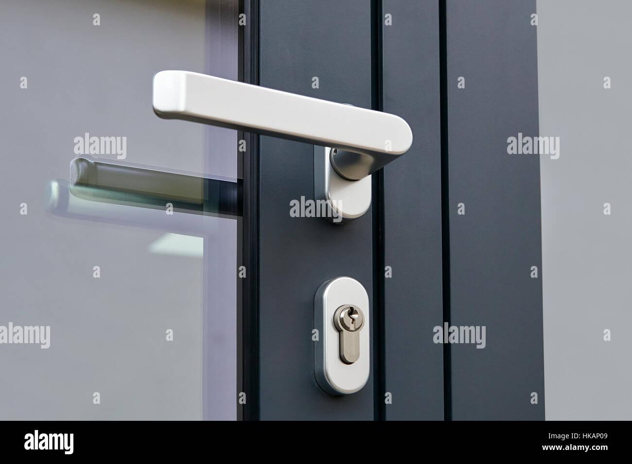 Exterior Door Handle And Security Lock On Metal Frame Stock Photo