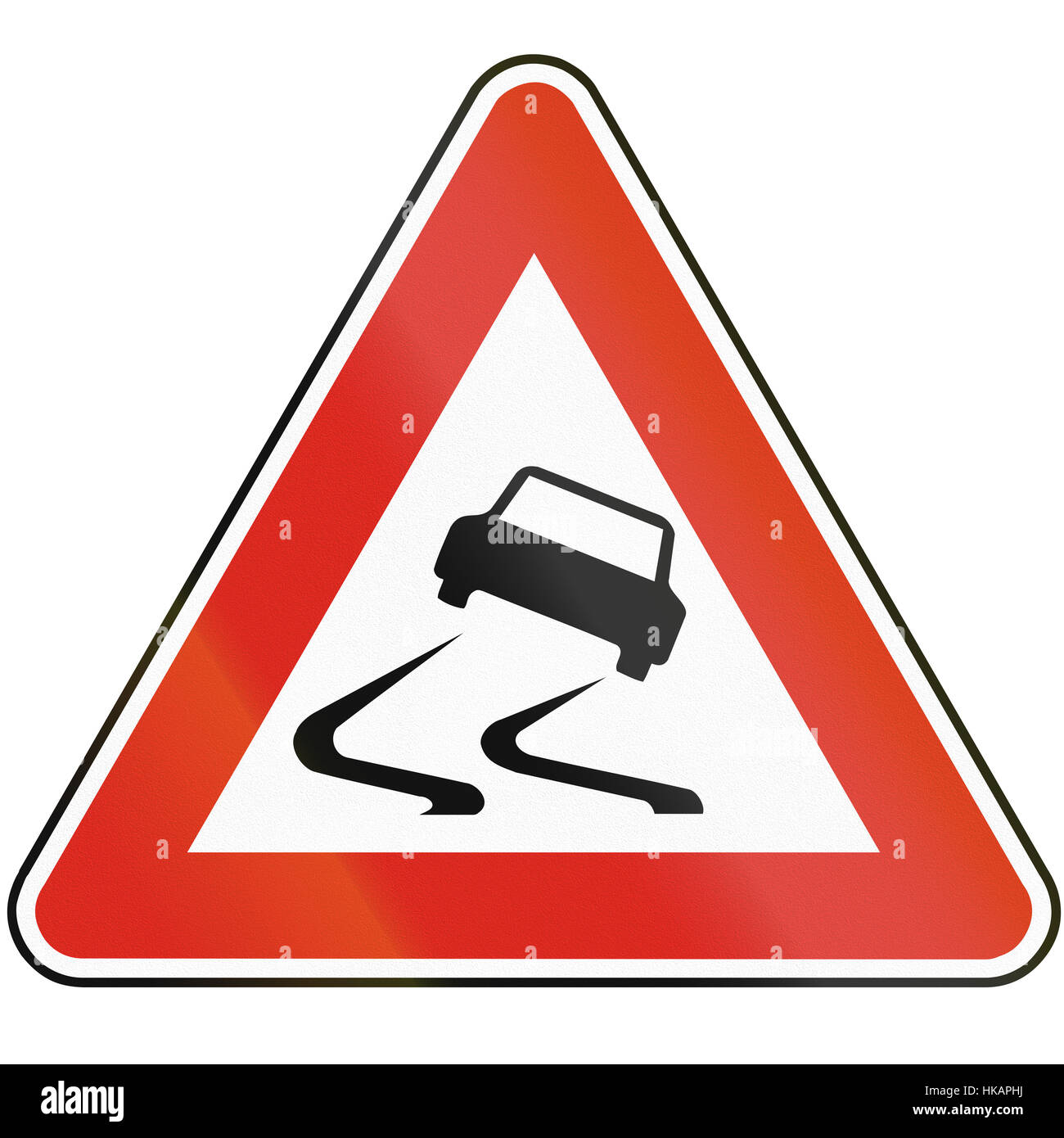 Road sign used in Slovakia - Risk of skidding. - Stock Image