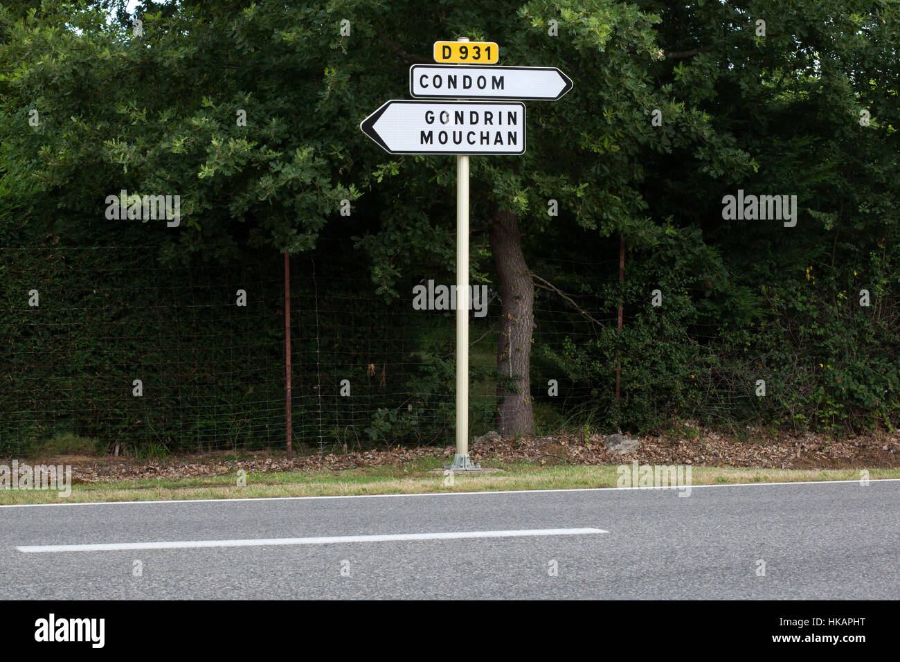 Direction traffic sign to Condom and to Gondrin and Mouchan next to the town of Condom in Gers, France. - Stock Image